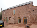 Conversion of a grade II listed barn into a private house